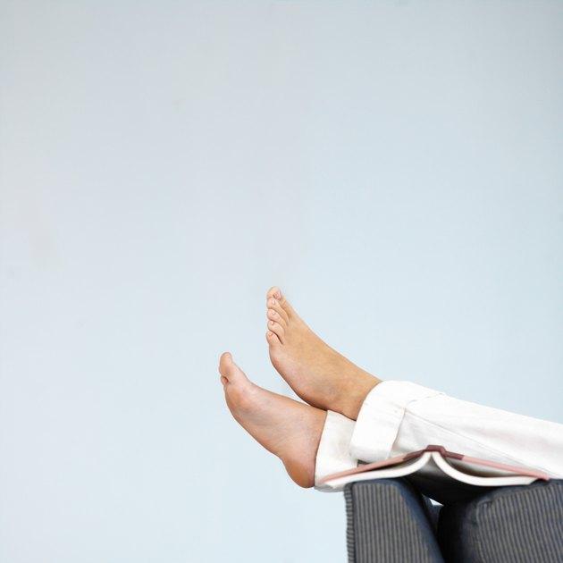 Woman's feet resting on a sofa