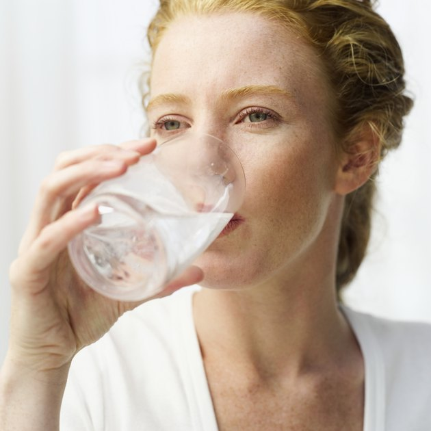 close-up of a woman drinking water from a glass
