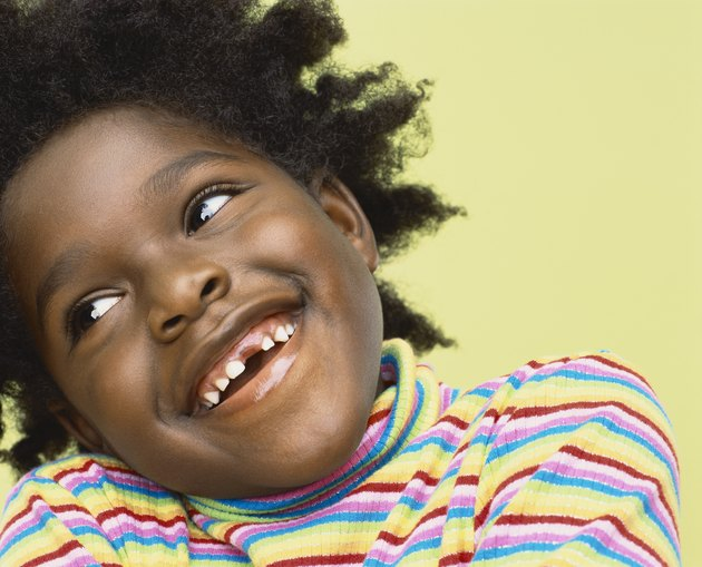 Close-Up Portrait of a Young Girl With Gappy Teeth