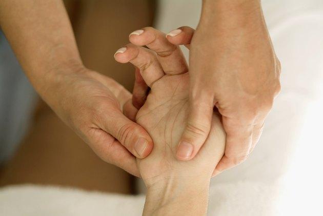 Person massaging a hand