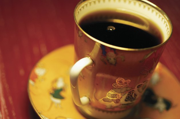 Black coffee in ornate coffee cup