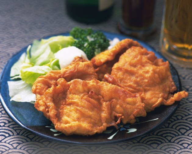 Fried chickens on plate, high angle view, differential focus