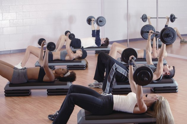 Exercise class lifting weights at gym