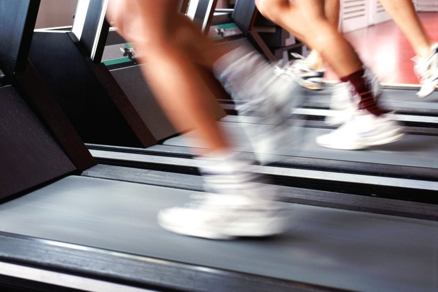 People running on treadmills (blurred motion)
