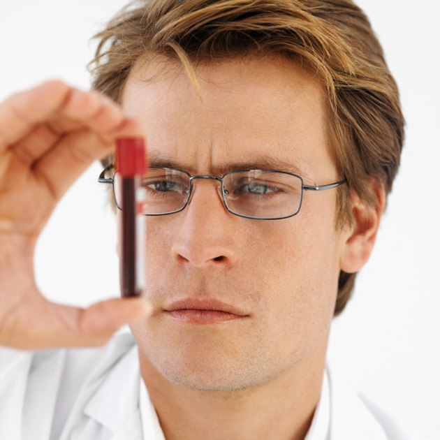 Close-up front view of a doctor holding blood sample