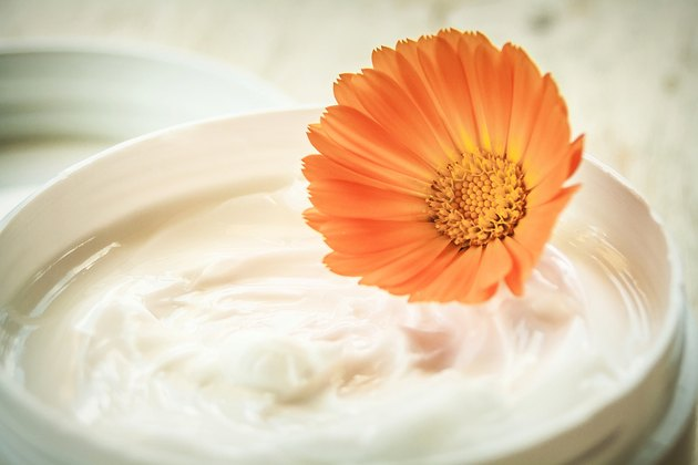 Moisturizing cream and marigold flower