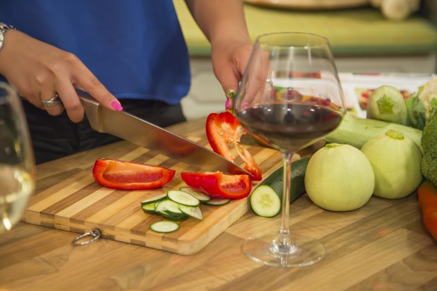 Woman slicing bell pepper for a healthy salad.