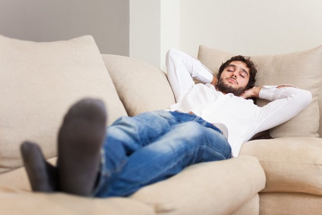 Man sleeping on his couch