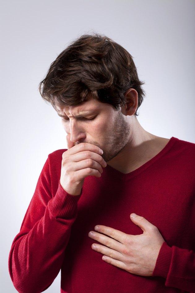 Ailing man suffering from pneumonia