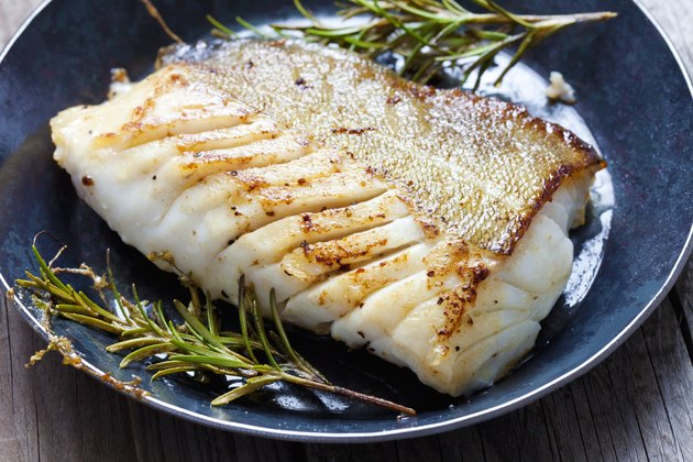 Fried fish fillet, Atlantic cod with rosemary in pan
