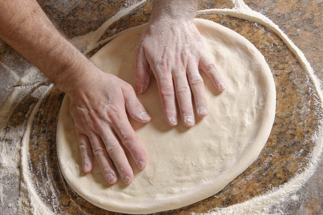 Chef Preparing pizza dough
