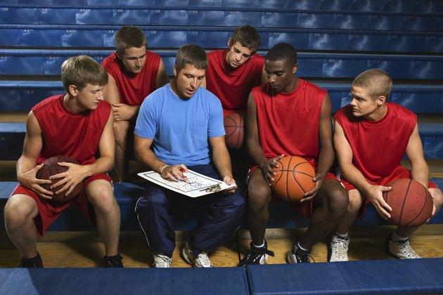 Basketball team and coach on bleachers