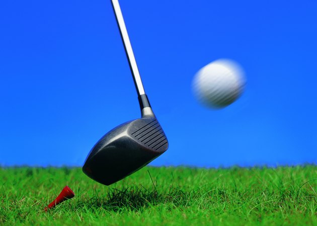 close-up of a golf ball as its hit by a golf club
