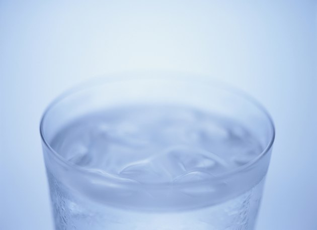 Glass of water, close up, blue background