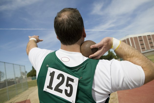 Male shot putter holding shot