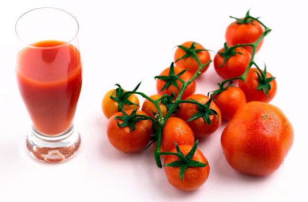 Tomatoes by glass of juice