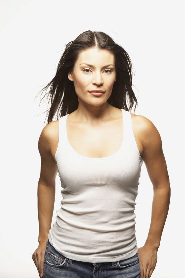 Portrait of woman in tank top with hands in pockets