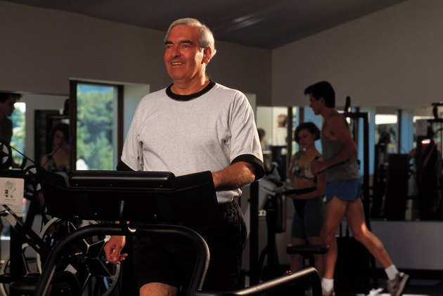 Man exercising on treadmill at gym