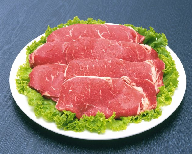 Raw beef on salad, high angle view