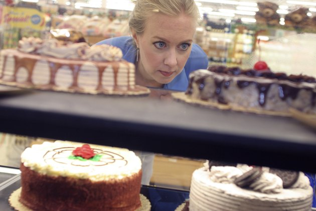 Mid adult woman looking at cakes in a supermarket