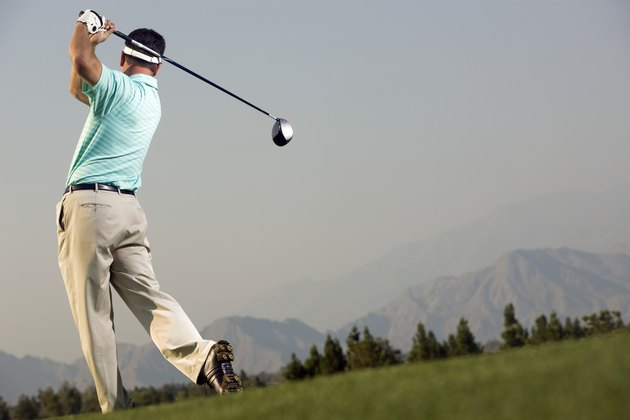 Golfer Hitting Ball Down Fairway