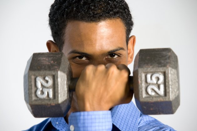 Man posing with dumbbell