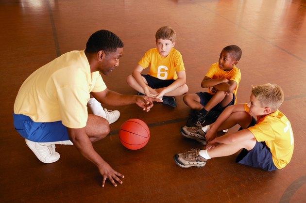 Boys with basketball coach