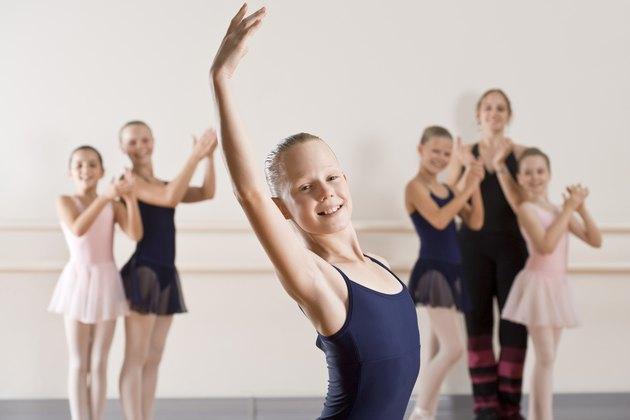 Dance class applauding ballerina