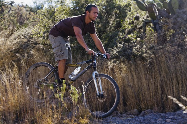 Hispanic man riding mountain bike