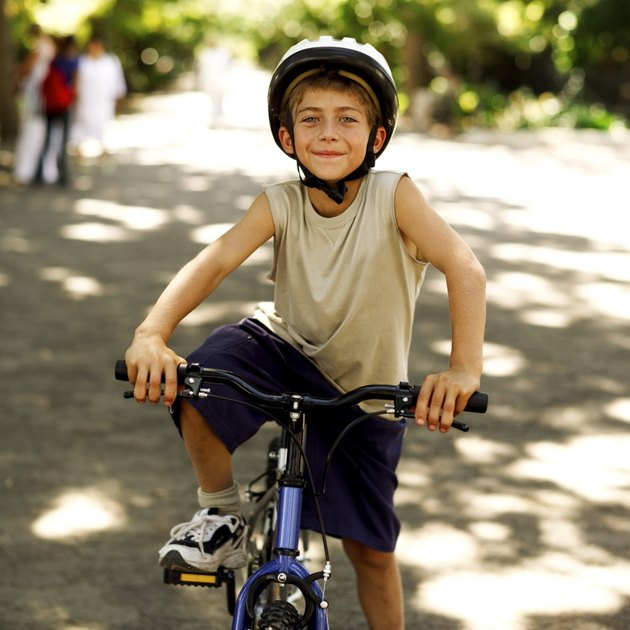 portrait of a young boy riding a bicycle