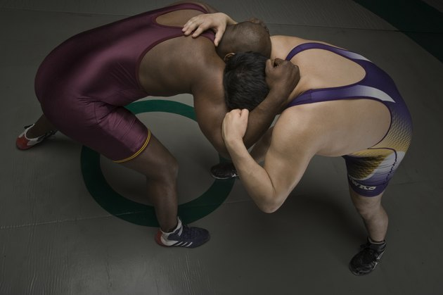 Two men wrestling, elevated view