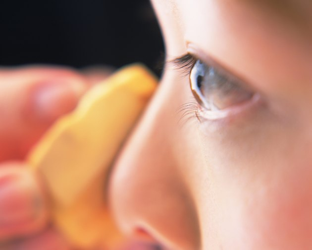 Closed Up Image of a Woman Applying Some Foundation, Differential Focus