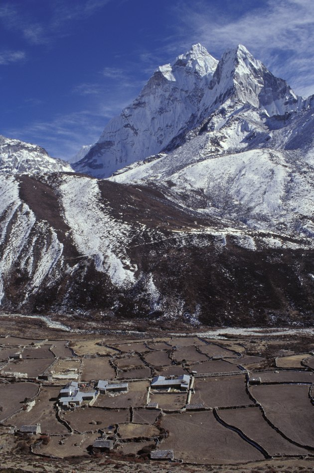 Mountainous landscape with valley and village in forefront