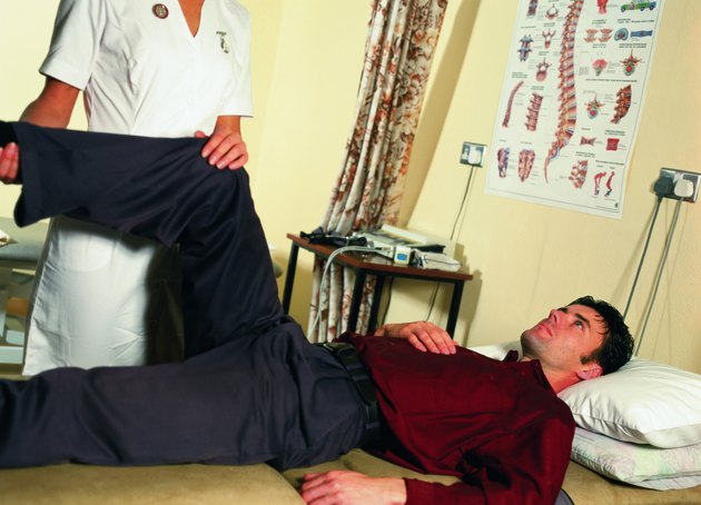 Nurse helping a patient with physiotherapy