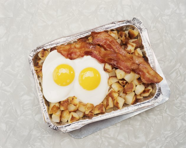 Fried Egg, Potatoes and Bacon in a Container