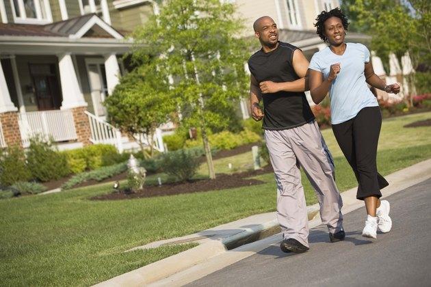 Couple running on street