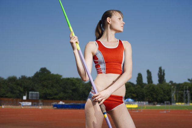 Young athlete posing with javelin