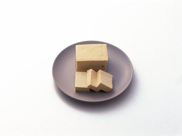 Slices of Tofu on plate, Momen Tofu, high angle view