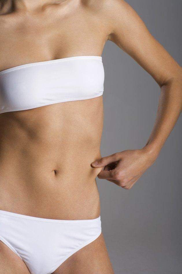 Woman in underwear pinching skin