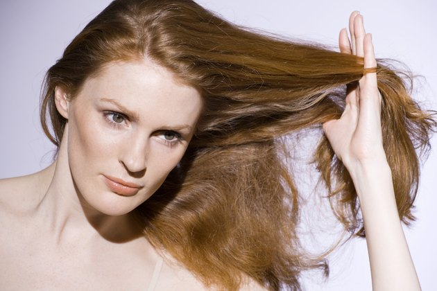 Woman with touching her hair