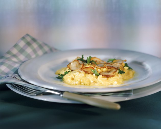 Scrambled eggs with edible mushroom in plate