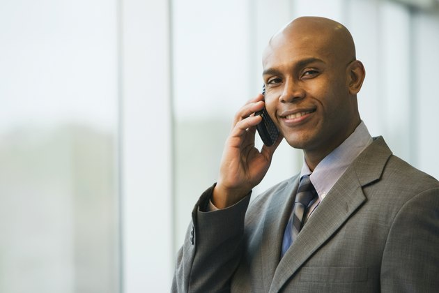 African businessman talking on cell phone