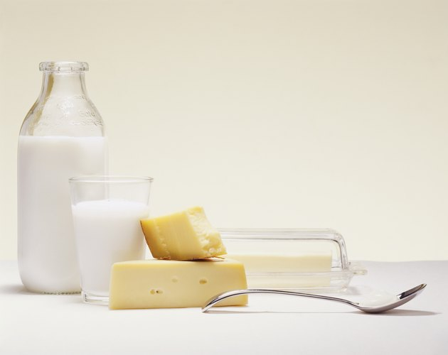 Milk Bottle, Glass of Milk, Cheese, Butter and a Spoon