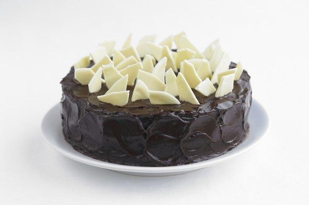 Chocolate cake garnished with white chocolate