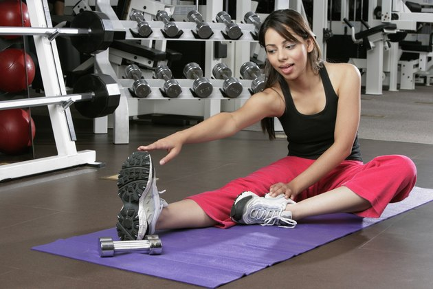 Young woman stretching on an exercise mat