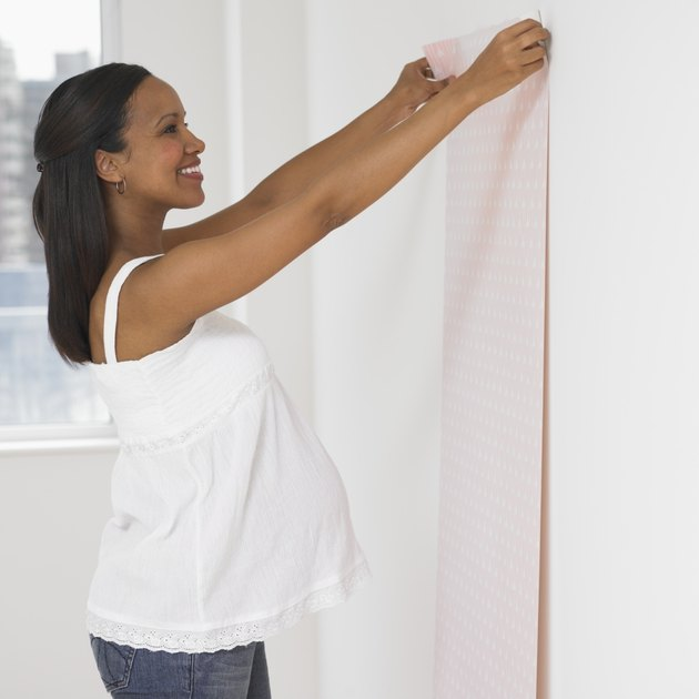 Pregnant African woman hanging nursery wall paper