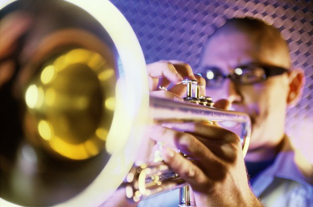 Close-up of a young man playing the trumpet