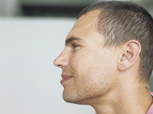 Young man smiling,profile,close-up