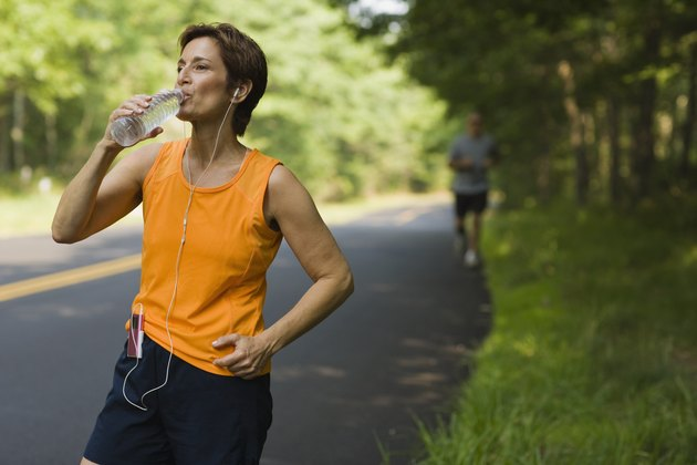 Jogger drinking bottled water