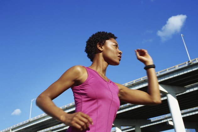 Low angle view of a young woman jogging